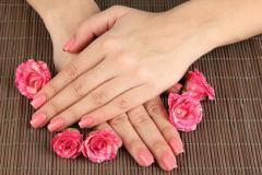 Pink fingernails and roses