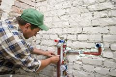 Plumbing contractor installing plumbing pipes