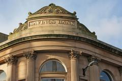 Savings bank sign on a vintage bank building