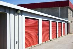 storage units with red garage doors