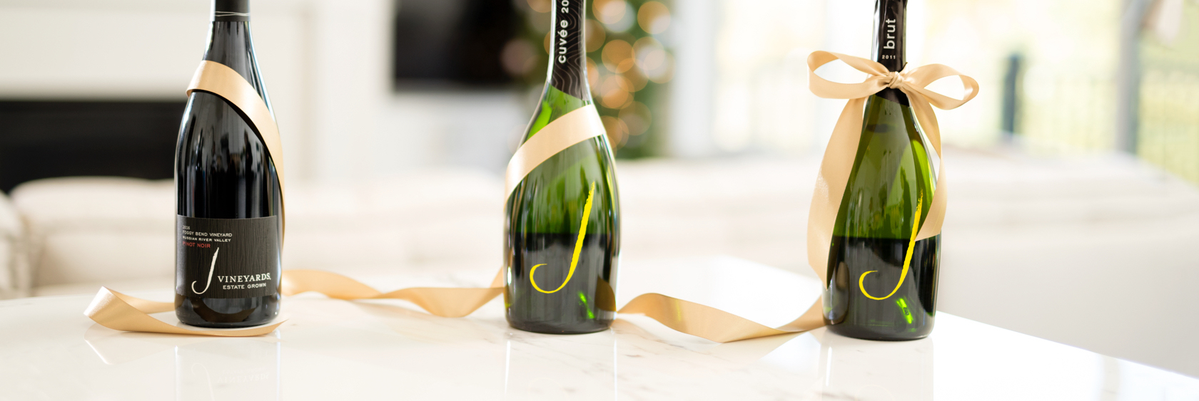 Three bottles of J Wines with a ribbon around them all
