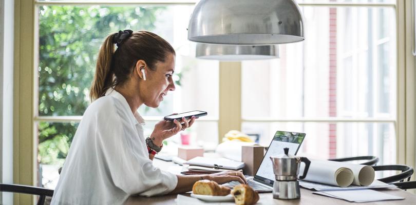 woman entrepreneur at table talking on phone