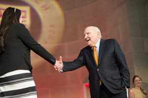 Jack Welch on Stage with graduate