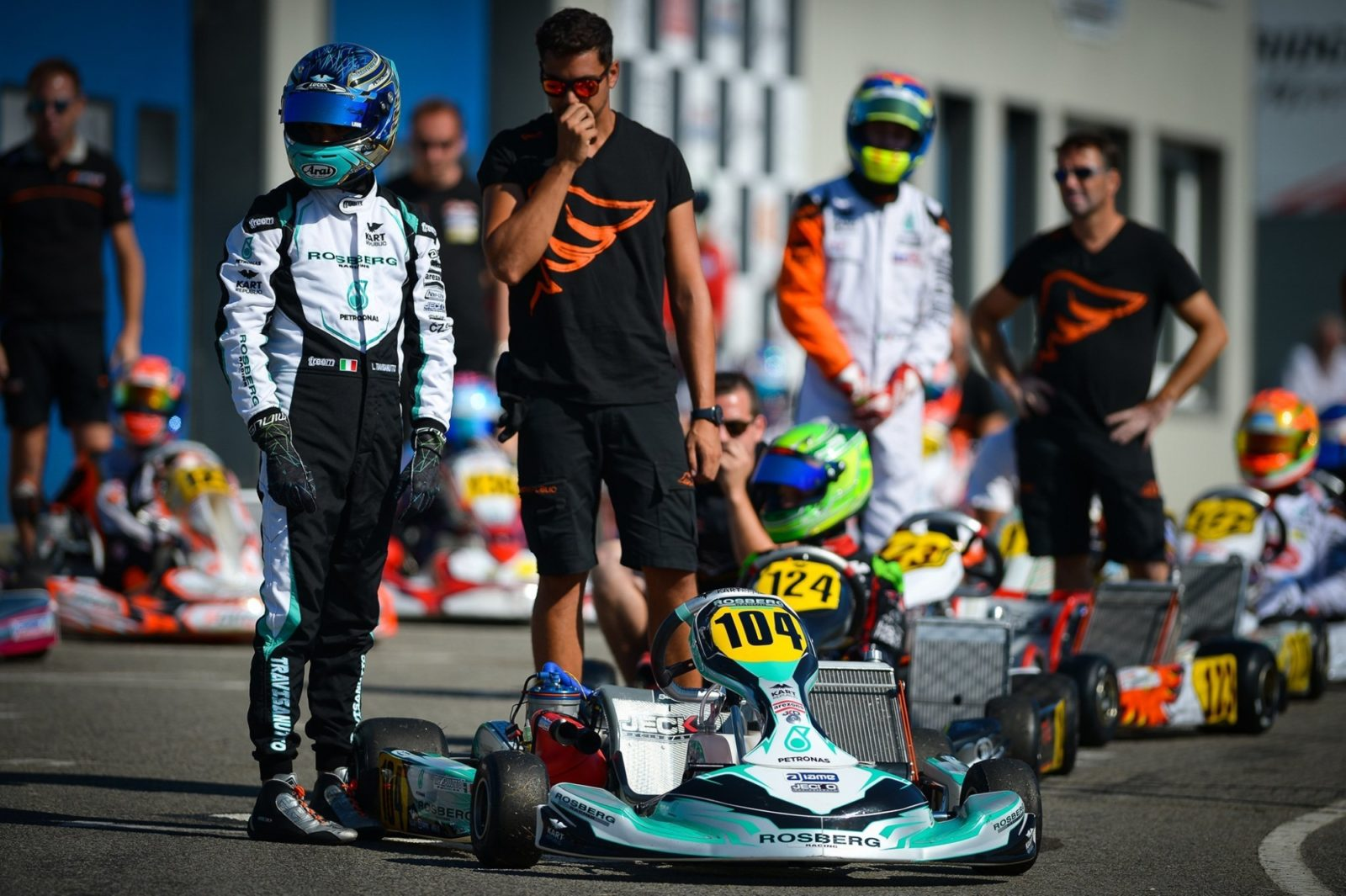 Lorenzo Travisanutto stands next to his Rosberg Racing Kart Republic ride
