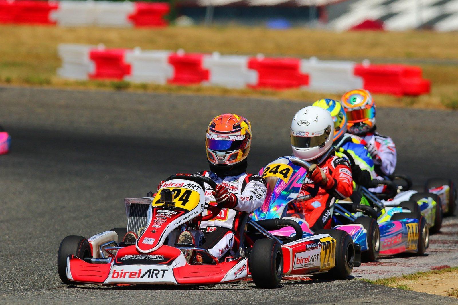 Thomas Nepveau leads a train of karts