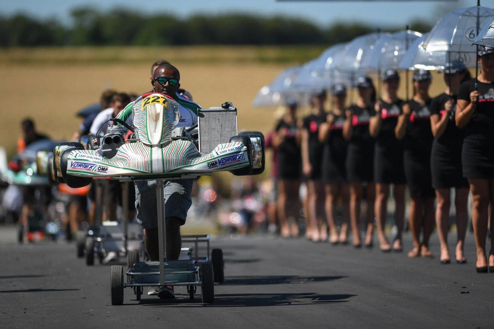 Tony Kart mechanic pushes kart to grid, Essay, France