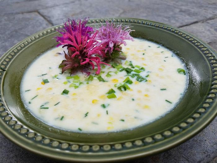 Fresh Corn With Chives And Flowers In Hot Milk