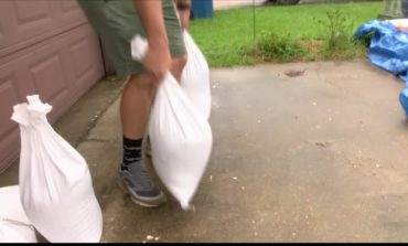 Neighbors brace for possible flooding