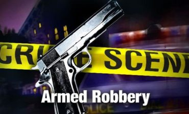 Armed Robbery Suspect Gets Away with Cash