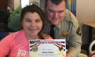Acadia Parish Deputy drives to NOLA to surprise student with her D.A.R.E. graduation certificate