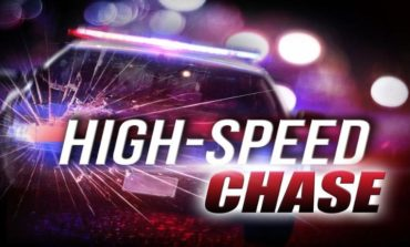 Woman flees from police, runs head-on into oncoming traffic