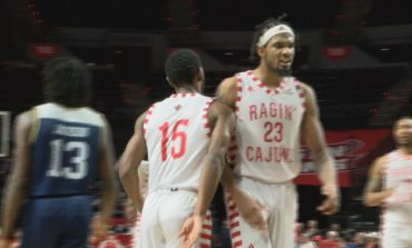 EAGLES CLIP CAJUNS IN FAST-PACED GAME, 103-86