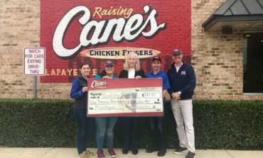 Raising Cane's Makes Donation to Three Local Animal Shelters