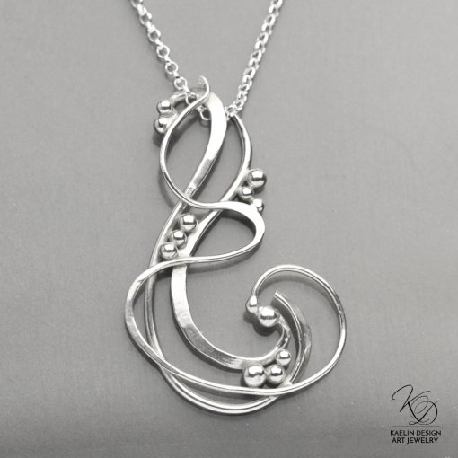 Waves hand forged silver pendant by Kaelin Design