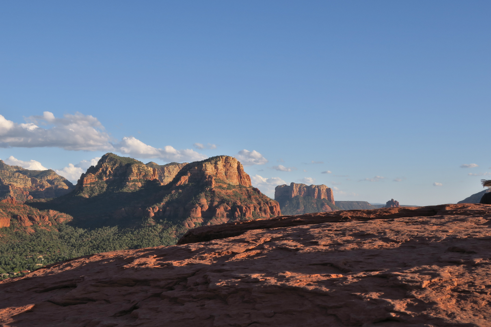 Photo of flat red rock overlooking mountains