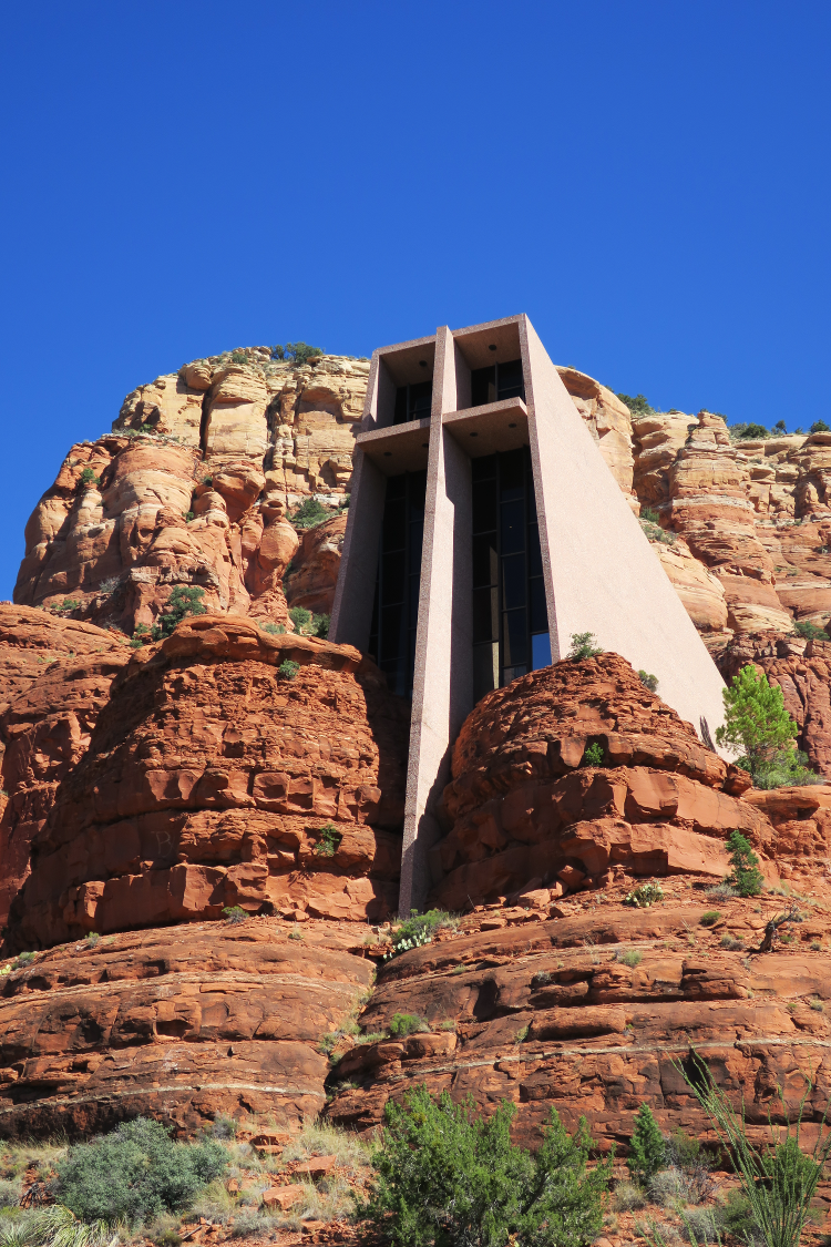 Photo of a chapel built into red rock mountains