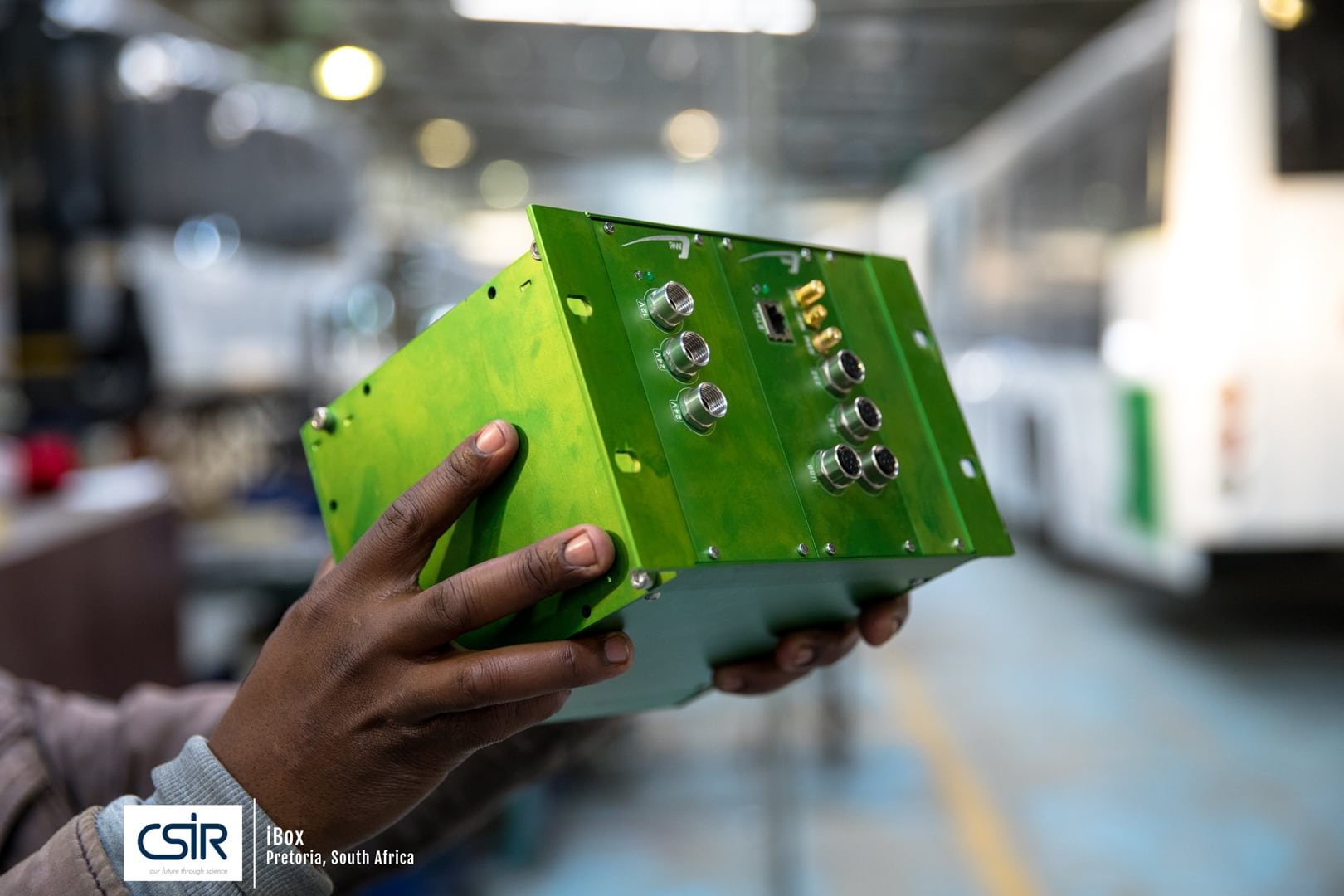 Science Photography of Man holding green box