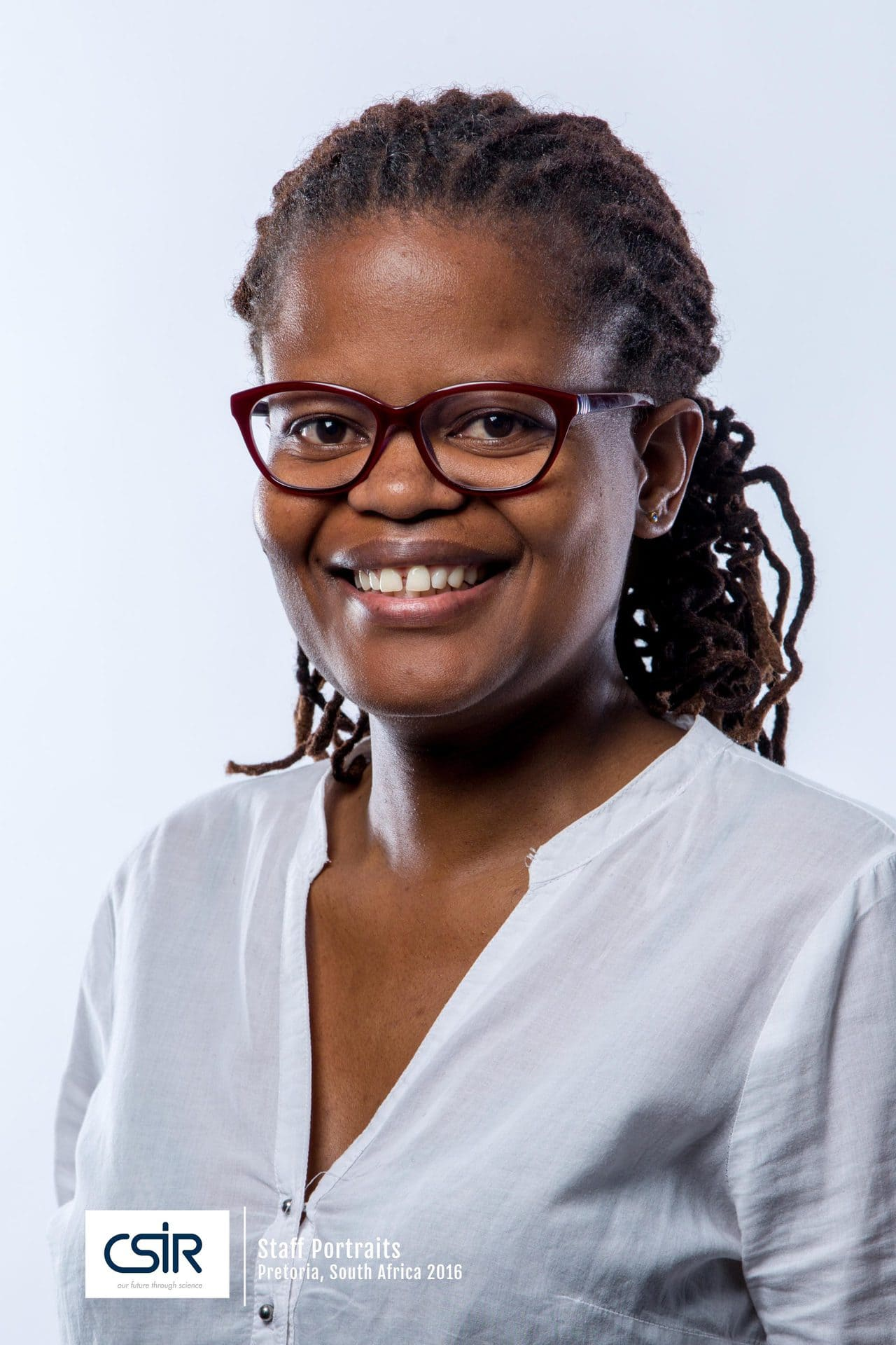 Portraits of  CSIR Staff - Black women with glasses and white top