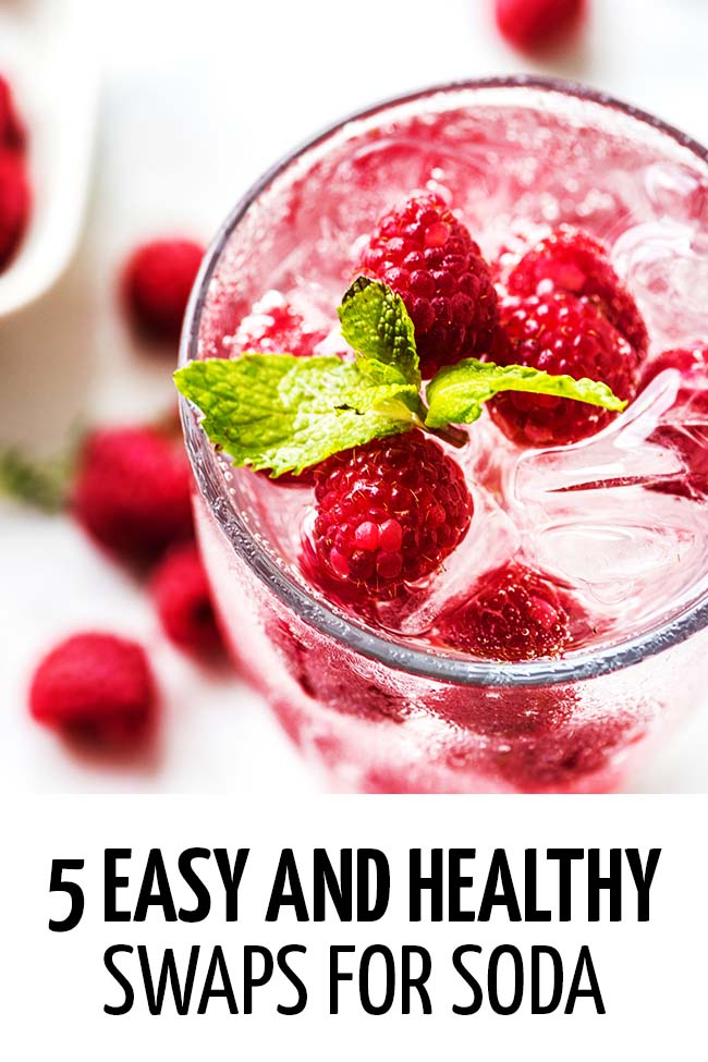 Clear colored soda with raspberries and some mint.  #weightloss #diet #dieting #dietplan #loseweightfast #loseweightfastandeasy #loseweightquick #losebellyfatinaweek #healthyeating #healthyliving #healhthylivestyle #healthylife #swapsforsoda #lesssugar