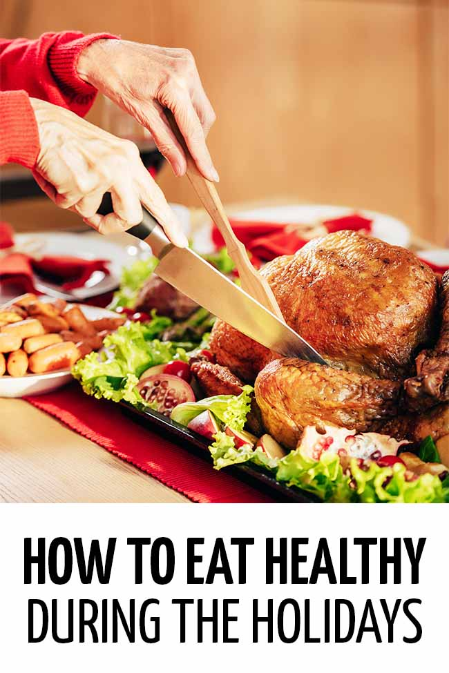 Woman slicing a holiday turkey. #weightloss #diet #dieting #dietplan #loseweightfast #loseweightfastandeasy #loseweightquick #losebellyfatinaweek #healthyeating #healthyliving #healhthylivestyle #healthylife