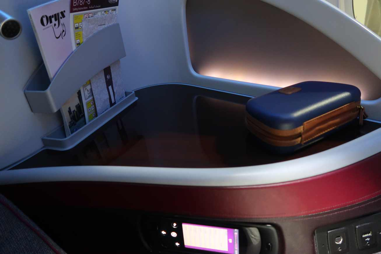 Qatar airways business class flight review onboard the amazing the tables in front of you make this pod feel like a workstation the table pulls out and folds over to create a large surface you could have a laptop and rubansaba