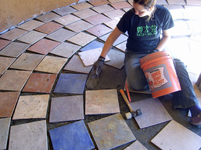 Mary Jane lays tile after leveling the floor