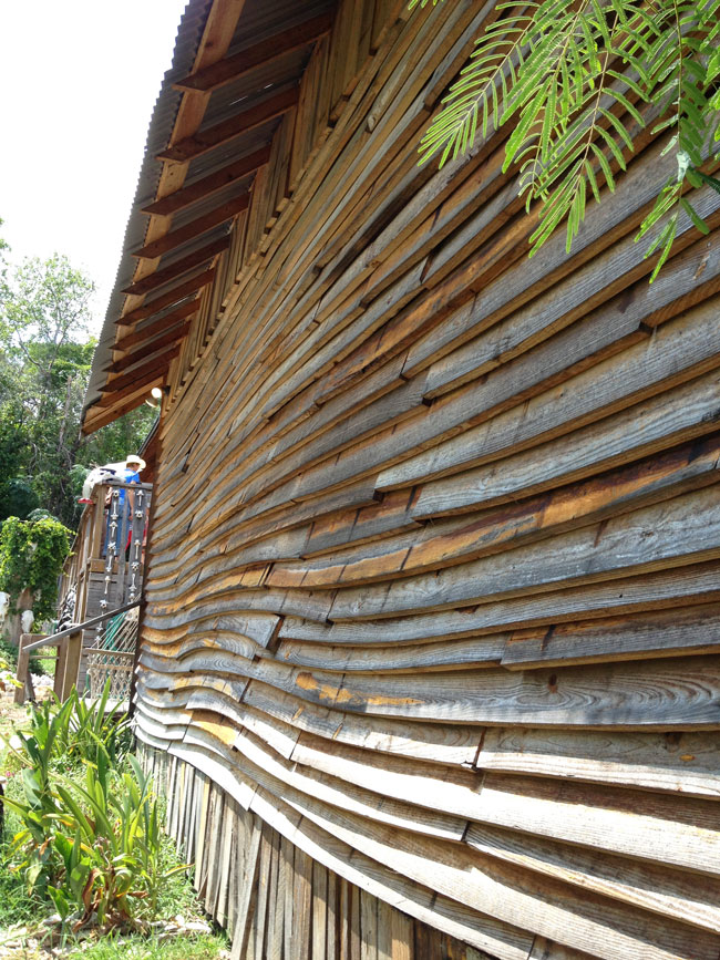 On this house Dan Phillips of Phoenix Commotion used warped boards to create a serpentine siding pattern.