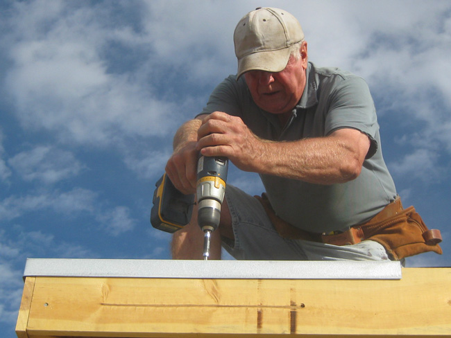 Dave installs a drip edge for the metal roof of the main house.