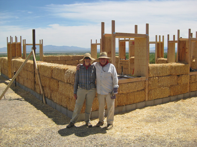 Dave and Barbara, with the 720 square foot strawbale main house taking shape.