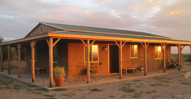 The finished strawbale house at sunset.