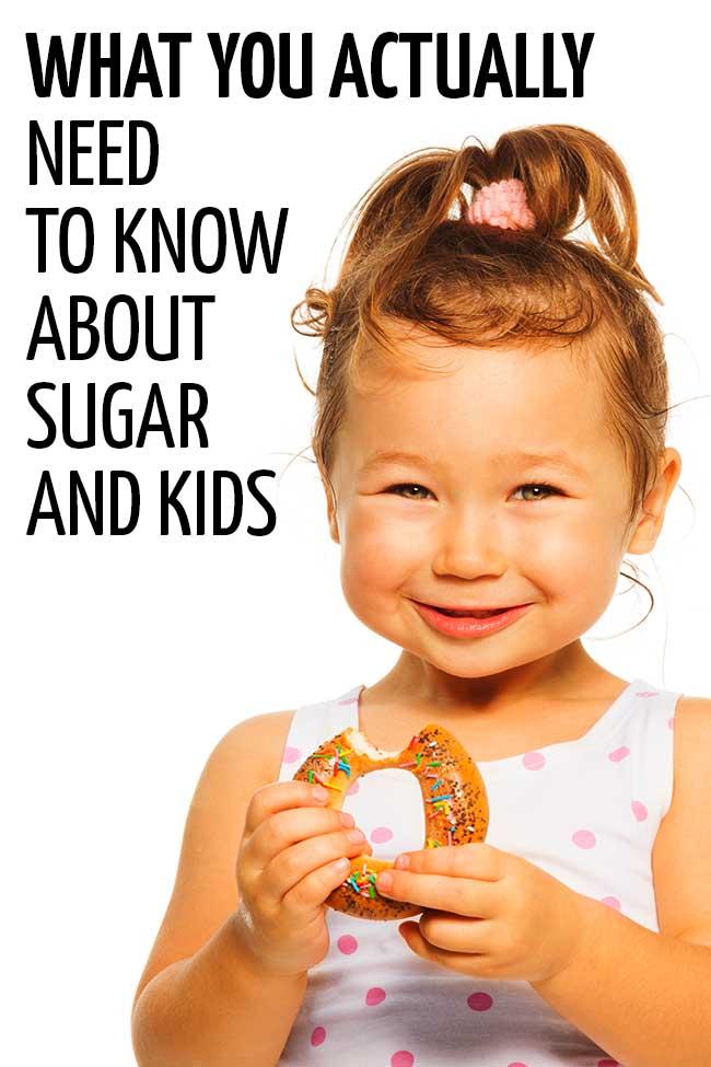 Little girl holding a doughnut. #toddler #fussyeater #fussytoddler #toddlerwonteat #pickyeater #parenting #positiveparenting #healthykids #preschooler #parenting #parentingtoddler #sugar #sugarfortoddlers