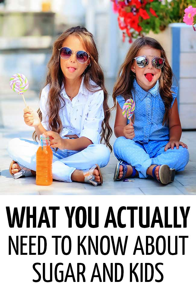 Two little girls eating lollipop and drinking a fizzy orange drink.  #toddler #fussyeater #fussytoddler #toddlerwonteat #pickyeater #parenting #positiveparenting #healthykids #preschooler #parenting #parentingtoddler #sugar #sugarfortoddlers