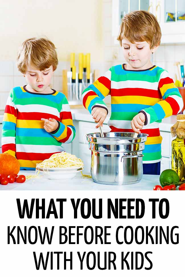 Two boys mixing a bowl of pasta in the kitchen #mealplanning #mealpreparation #healthymeals #foodpreparation #healthyfood #cookingwithkids #kidsinthekitchen