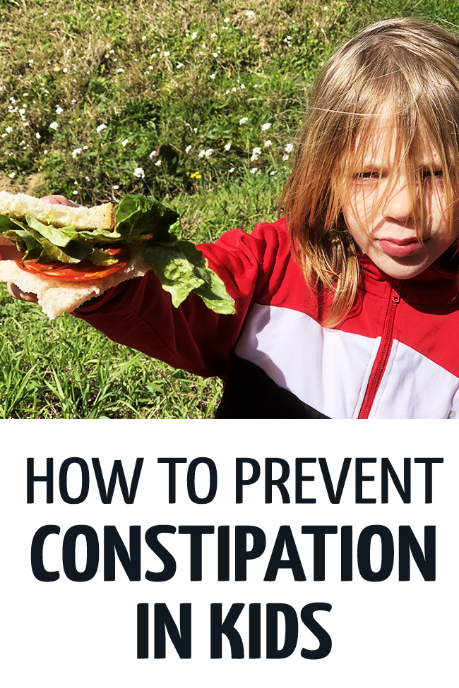 Boy holding a sandwich with tomatoes and lettuce to help him from being constipated. #toddler #fussyeater #fussytoddler #toddlerwonteat #pickyeater #parenting #positiveparenting  #healthykids #preschooler #parenting #parentingtoddler #constipation #constipationkids #constipationreliefkids