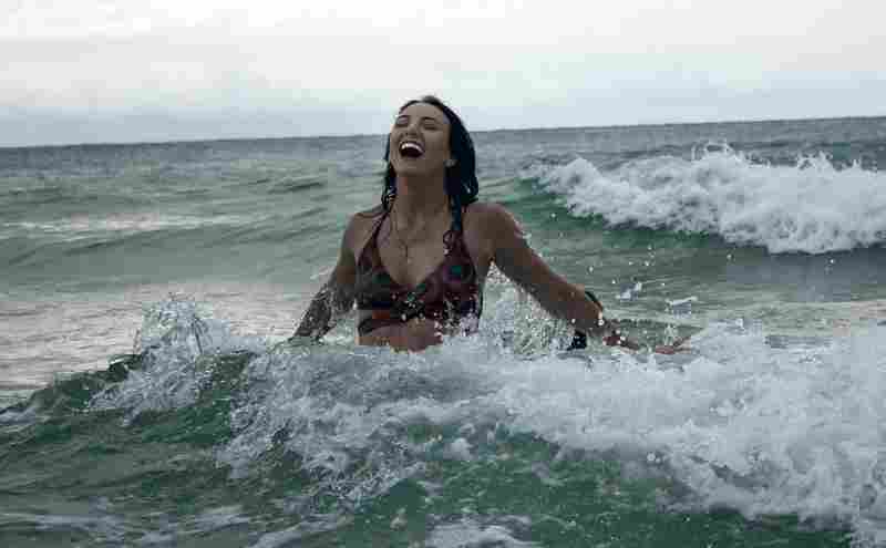 a woman swimming in the ocean as cold therapy