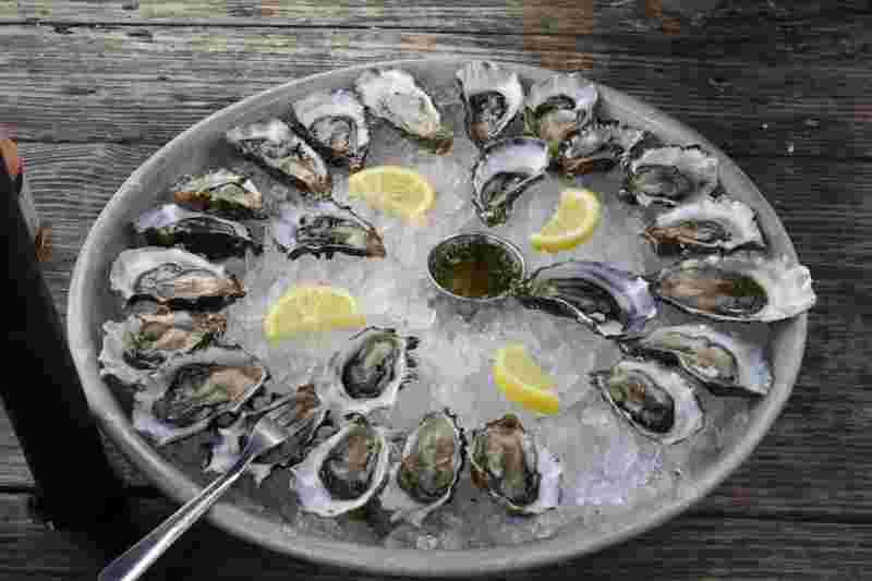 oysters with lemon or lime, shown for their beauty