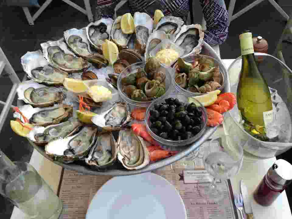 Oysters are displayed, which contain DHA, which can decrease sunburn risk