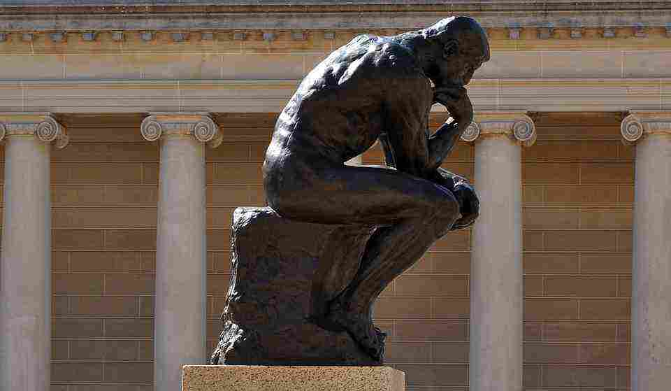 a picture of the thinker, which is an analogy for questioning the dogma regarding safe tanning
