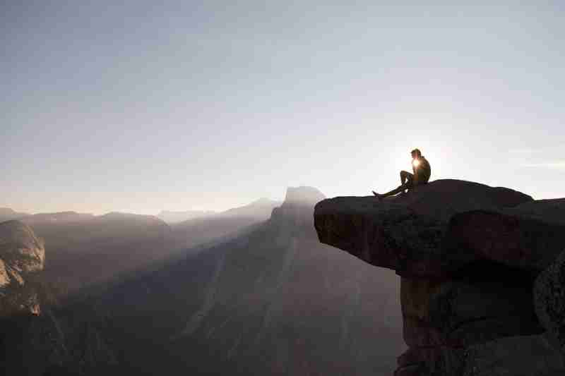a lonely person on top of a hill, exemplifying dopaminergic qualities