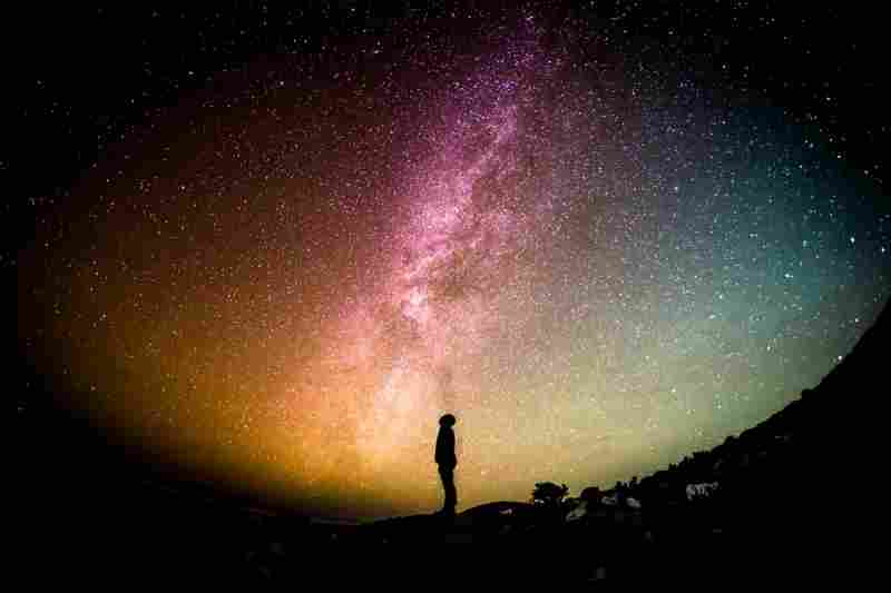 a person looking at the cosmos, as an analogy of the far-sightedness created through dopamine
