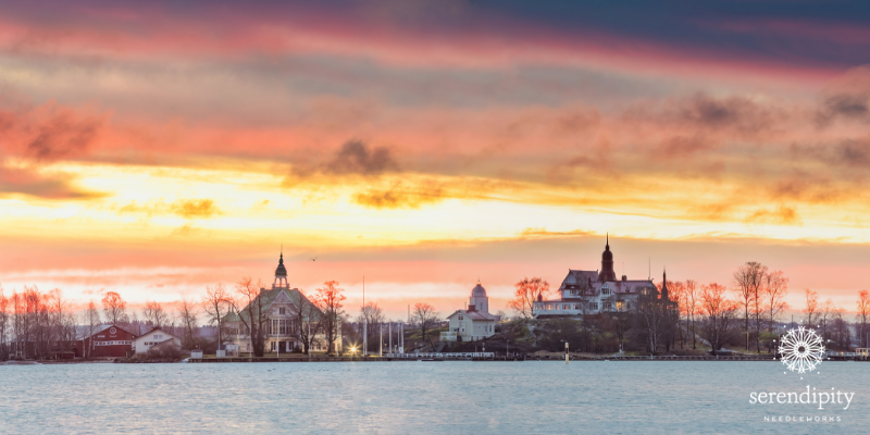 A wintry watercolor sunrise over the harbor in Helsinki, Finland.