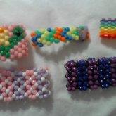 2 Xbase Cuffs, A Turtle, Arrow Cuff, And Cuff Made Outa Peral Beads