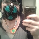 mask and necklace