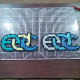 2 New Edc Logos. Playing With Striped Perler Beads