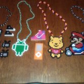 Perler Necklaces And Some Earrings.