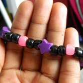 Black Single With Glow In The Dark Pink, And Plain Purple Star Beads