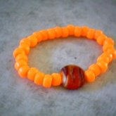 Orange With A Glass Bead
