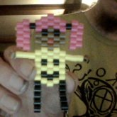 Chibi Girl Wearing A Smileyface Shirt Made From Perler Beads