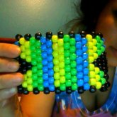 Yellow Green And Blue Cuff With Black Arrows On The Side