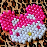 THE STARRY EYED SERIES Pink Starry Eyed Hello Kitty Wearing A Deadmau5 Hat